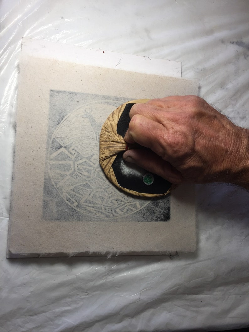 This is a block print of The Hand and Spiral on handmade paper by Michael Colombo and Barbara Barkley