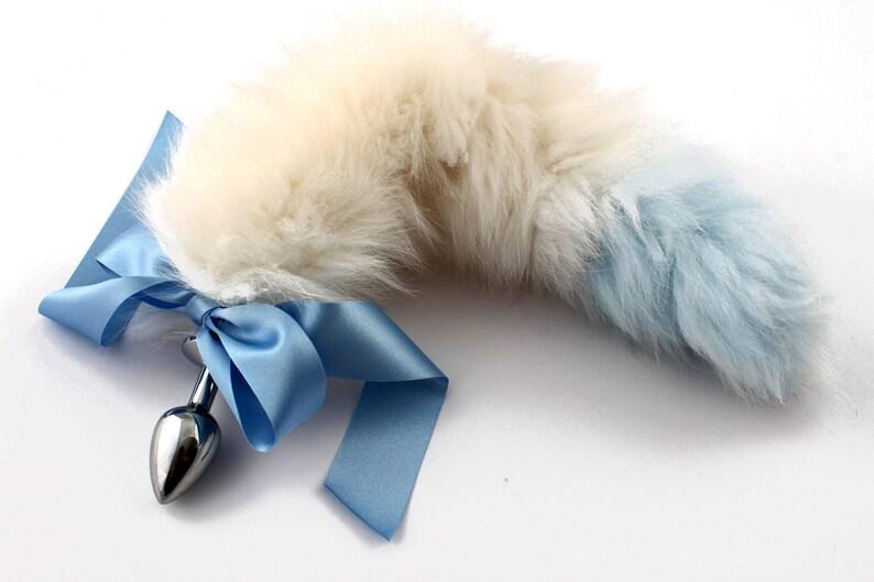 3323fc7ca Blue tip white petplay tail butt plug. Beautiful faux fur hand