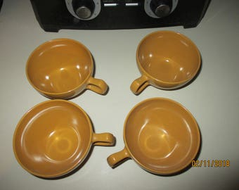 A vtg lot of 4 coffee cups--oneida premier--gold or mustard-nice cond.
