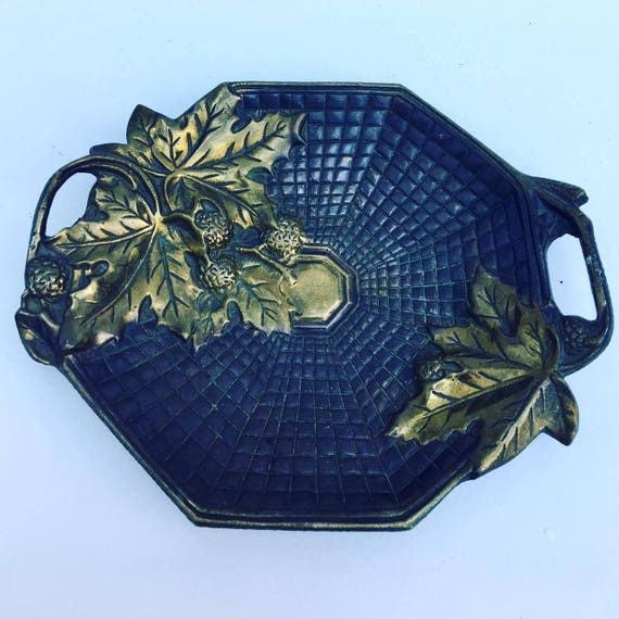 Antique bronze trinket bowl , bronze cup, bronze dish, bronze tray representing grape leafs which dates from the early 20th century.