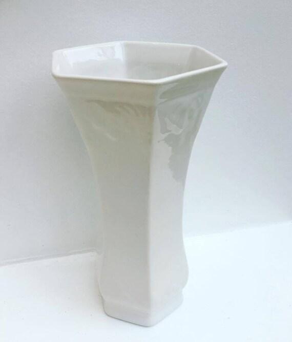 Boch La Louvière: Art-deco vase, white enamelled earthenware, relief decor, flowers motif, signed under Belgian earthenware base, European