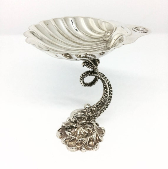 Shell Dish Vintage Cutajar works Malta Metal shell bowl on top of Dolphin Fish Ornament Maltese Cross