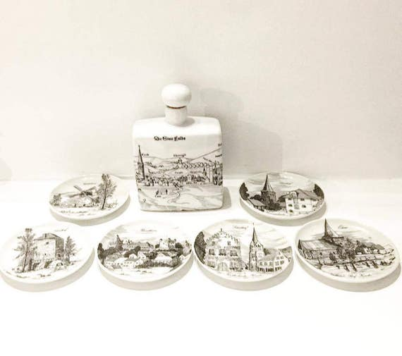 Vintage German set of liqueur flask, carafe, decanter and 6 small plates with images of German cities, porcelain, German landscapes