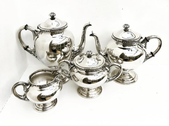 Coffee and tea silver plated set by Bruno Wiskemann, Style Empire Belgium 1930, Teapot, coffee pot, sugar bowl and creamer