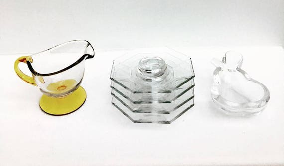 Vintage transparent glass, set of 6 pieces, pear shaped crystal bowl, 4 egg cups and a sauce gravy boat. Heavy glass, vintage glass