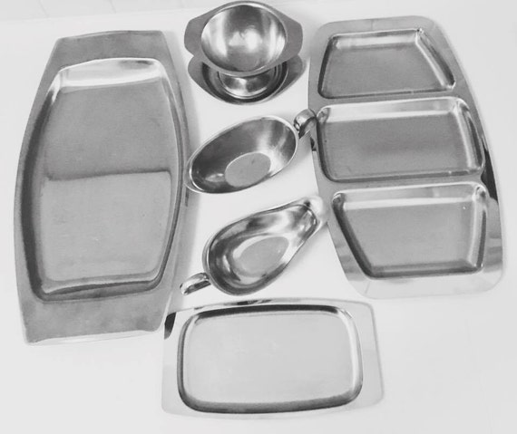 Scandinavian  serving plates Vintage stainless steel trays and saucepans of The 60s  Trays vintage stainless steel tray service tray steel .