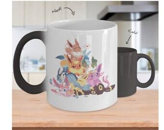 EEVEELUTIONS Color Changing Magic Mug Eevee Evolutions In A Cute Pile Jolteon Espeon Leafeon Umbreon Flareon Sylveon Vaporeon Glaceon