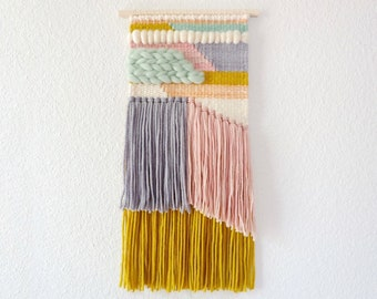 Purple and mustard handwoven wall hanging. Crystal quartz natural stone attached wire. Metallic silver details. Ready to ship tapestry.
