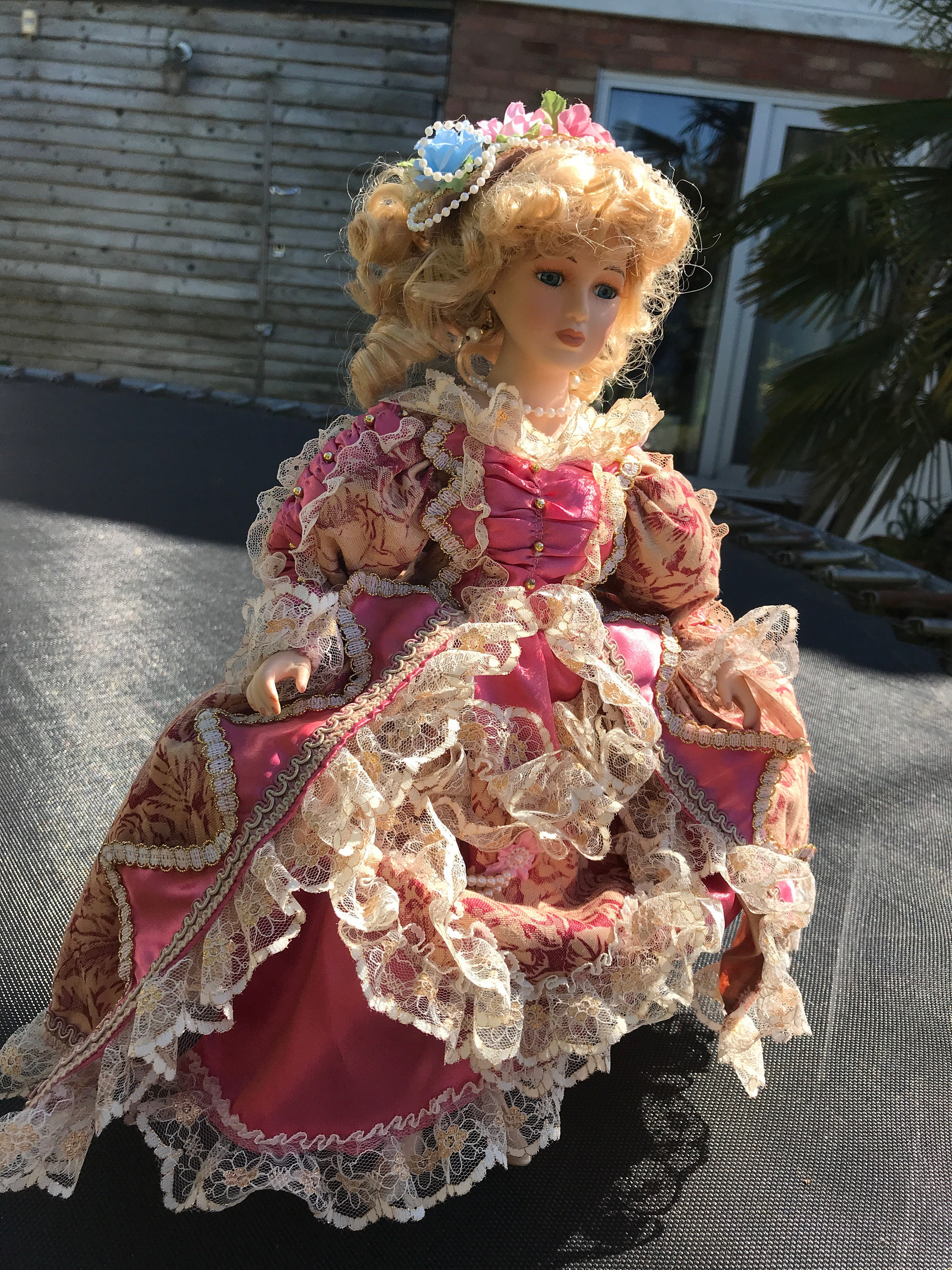 collectible porcelain doll in pink dress , D S N Collection,with stand