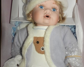 porcelain Leonardo collection baby doll boy with teddy bear  ,large size,label ,certificate , boxed