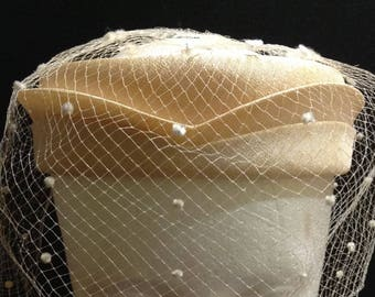 Union made very light orange/yellow open pillbox hat with flocked netting, 19 1/2 inches, made in USA.