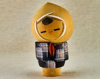 Kokeshi wooden doll. Child in haori. Vintage traditional Japanese Kokeshi doll.