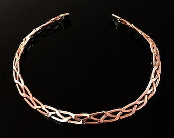Magnetic necklace in copper and brass, braided, with all its benefits