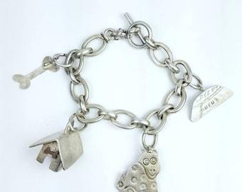 Vintage Native American Navajo handmade Sterling Silver charm bracelet