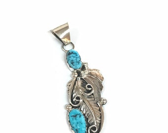 Native American Navajo handmade sterling silver pendant set with Kingman turquoise stones