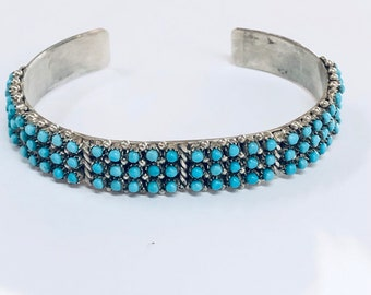 Native American Zuni handmade sterling silver cuff bracelet set with fine cut Sleeping Beauty Turquoise