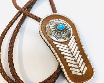 Bolo Tie: Native American Navajo handmade Sterling Silver and leather bolo