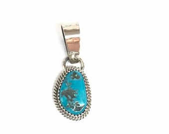 Native American handmade sterling silver pendant set with turquoise stone