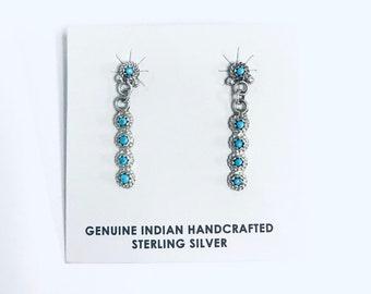 Native American Zuni handmade sterling silver dangle earrings set with Sleeping Beauty Turquoise stones