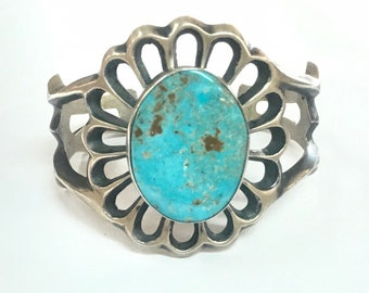 Vintage 1970's Native American handcrafted sand cast heavy gauge sterling silver cuff bracelet set with Blue Gem turquoise stone