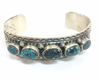 Native American Navajo handmade heavy gauge sterling silver unisex cuff bracelet set with Red Mountain Turquoise