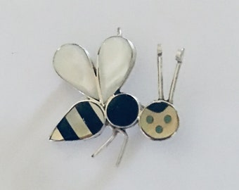 Native American Zuni handmade sterling silver Bee pendant inlaid with white and yellow mother of pearl and black onyx and turquoise eyes