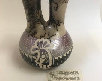 Native American Navajo handmade pottery that is etched and with horse hair fired into pot