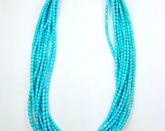 Native American Navajo handmade necklace. High grade Sleeping Beauty Turquoise with 14kt Gold Hooks and cones.