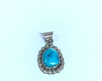 Native Anerican Navajo handmade sterling silver pendant set with Turquoise stone