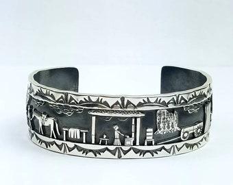 Native American Navajo handmade Sterling Silver Story Teller cuff bracelet