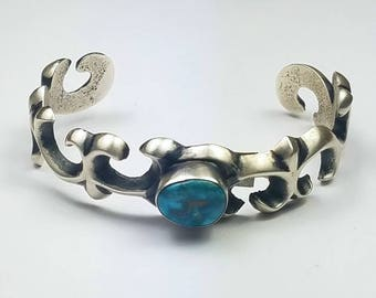 Native American Navajo handmade Sterling Silver sand casted natural high grade Blue Gem Turquoise cuff bracelet