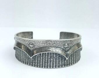 Native American Navajo handmade Tuffa cast Sterling Silver cuff bracelet