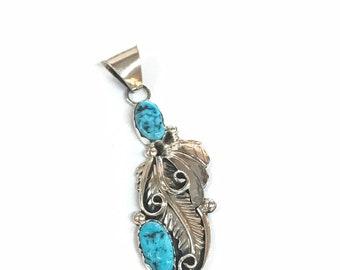 Native American Navajo handmade sterling silver pendant set with Kingman turquoise stones