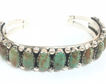 Native American Navajo handmade sterling silver unisex cuff bracelet set with Stormy Mountain turquoise