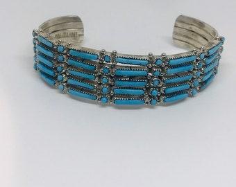 Native American handmade Zuni Needlepoint sterling silver cuff bracelet set with fine cut Sleeping Beauty Turquoise