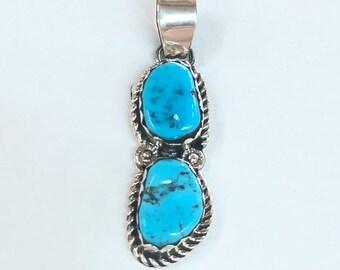 Native American Navajo handmade sterling silver and Kingman turquoise pendant
