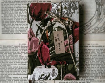 A 1941 printing of 'Rebecca' by Daphne Du Maurier covered in 1950's fabric reclaimed from curtains.