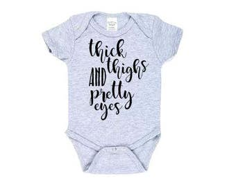 e5dcd79d0 Thick thighs and pretty eyes onesie