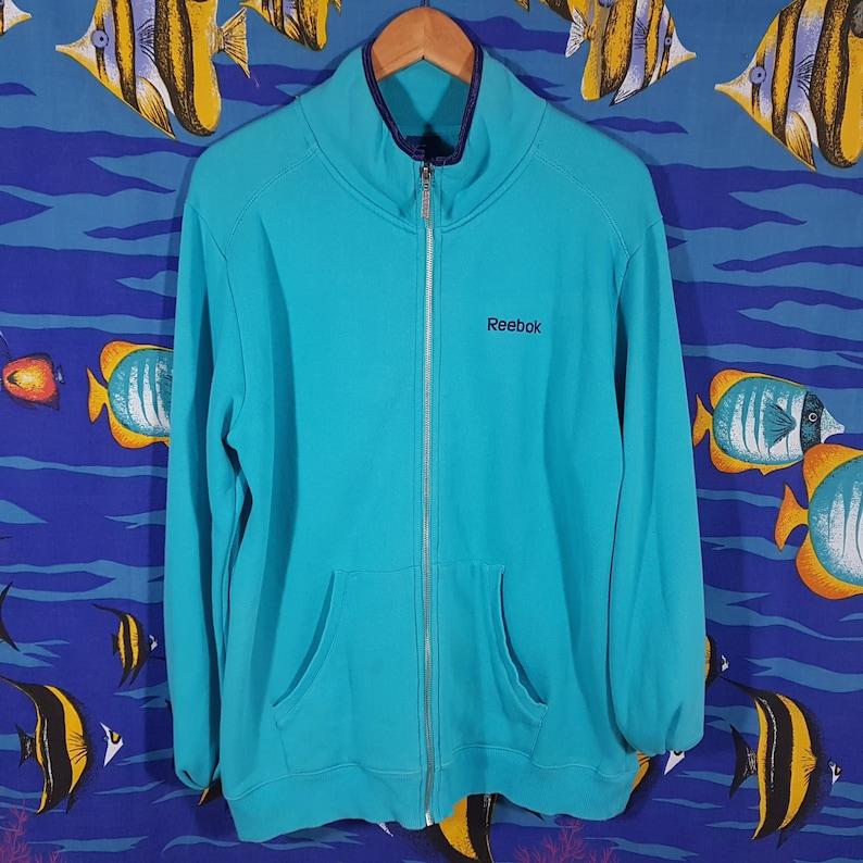 e374559ba9d77 Vintage Reebok Jumper Size Large Vintage Windbreaker Track Jacket VTG  Streetwear Sweater Tracksuit Aqua Green Blue