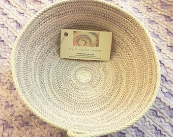 Medium sized clothesline rope bowl with violet variegated thread