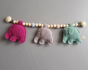 Stroller toy with crocheted elephants