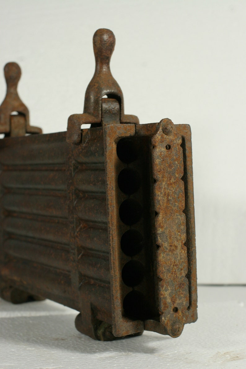 Taper candle mold  antique French cast iron hinged 12 candle mold  late 1800s to early 1900s  used in churches /& monasteries