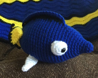 Crocheted afghan and stuffed fish (Dory)