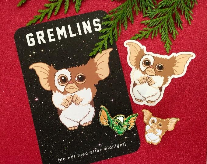 Featured listing image: Gremlins Gift Set - 2 enamel pins, 1 print/ postcard and 1 vinyl sticker