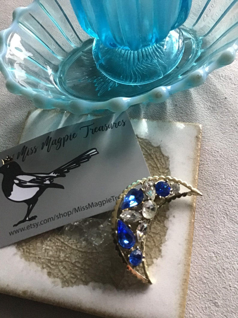 1950\u2019s vintage Crescent moon brooch with Sapphire glass crystal detail