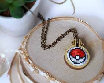 pokeball xstitch necklace. cross stitch pokemon pokeball pendant. wood embroidery hoop. stitched gamer necklace. gamer gift idea under 30