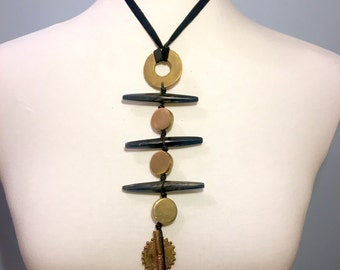 Handmade necklace cast brass and carved buffalo horn