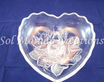 Heart shaped floral candy dish on stand.
