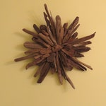 Driftwood Wall Art Flower - Rich natural beauty arranged artistically to suit any decor.
