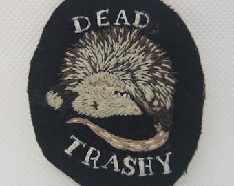 Dead trashy opossum patch